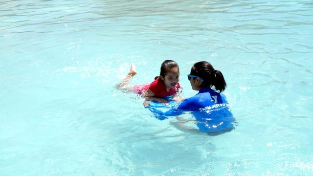 kids in pool with adult
