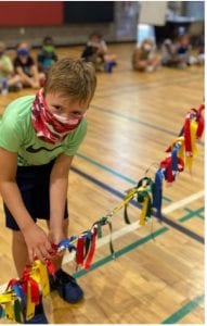 A boy playing at day camp