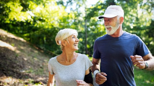 A senior couple walking for healthy living